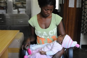 [RELEASE OBTAINED] Natasha Chisenga Simpasa holds her six-week-old daughter, Mutale, in the Chelstone Clinic in Lusaka, the capital. Ms. Simpasa is HIV-positive, and has brought Mutale for her first HIV test. Ms. Simpasa participated in the clinics PMTCT programme for her sons, 20-month-old Fanwick and four-year-old Masonda, both of whom are HIV-negative. She is now participating in PMTCT for Mutale. [#2 IN SEQUENCE OF NINE] In October 2010 in Zambia, the Chelstone Clinic in Lusaka continues to provide vital programmes to treat HIV-positive pregnant women and to prevent mother-to-child transmission of HIV (PMTCT). Some 95,000 Zambian children under age five are infected with HIV; the vast majority contracted the illness from an HIV-positive mother during pregnancy, delivery or breastfeeding. PMTCT programmes include HIV testing during pregnancy, antiretroviral (ARV) regimens for sick HIV-positive pregnant women, and early diagnosis and treatment for infants exposed to HIV in utero. Participating infants receive prophylactic antibiotics and ARVs in the weeks after they are born, and are administered HIV tests at six weeks. If breastfed by an HIV-positive mother, infants continue to receive prophylactics and are tested again at 12 months and 18 months (and three months after breastfeeding ceases or at any age if they fall ill). HIV-positive infants diagnosed and treated within the first 12 weeks of life are 75 per cent less likely to die from the disease. Zambia has recently made great strides in expanding PMTCT programmes. In the second quarter of 2009, ARVs were administered to approximately half of all children in need and to some 57 per cent of HIV-positive pregnant women. However, many infants still do not receive PMTCT services because their caretakers lack access to properly equipped facilities, or fear the stigma associated with HIV, or find it difficult to adhere to the structured course of required tests and services.