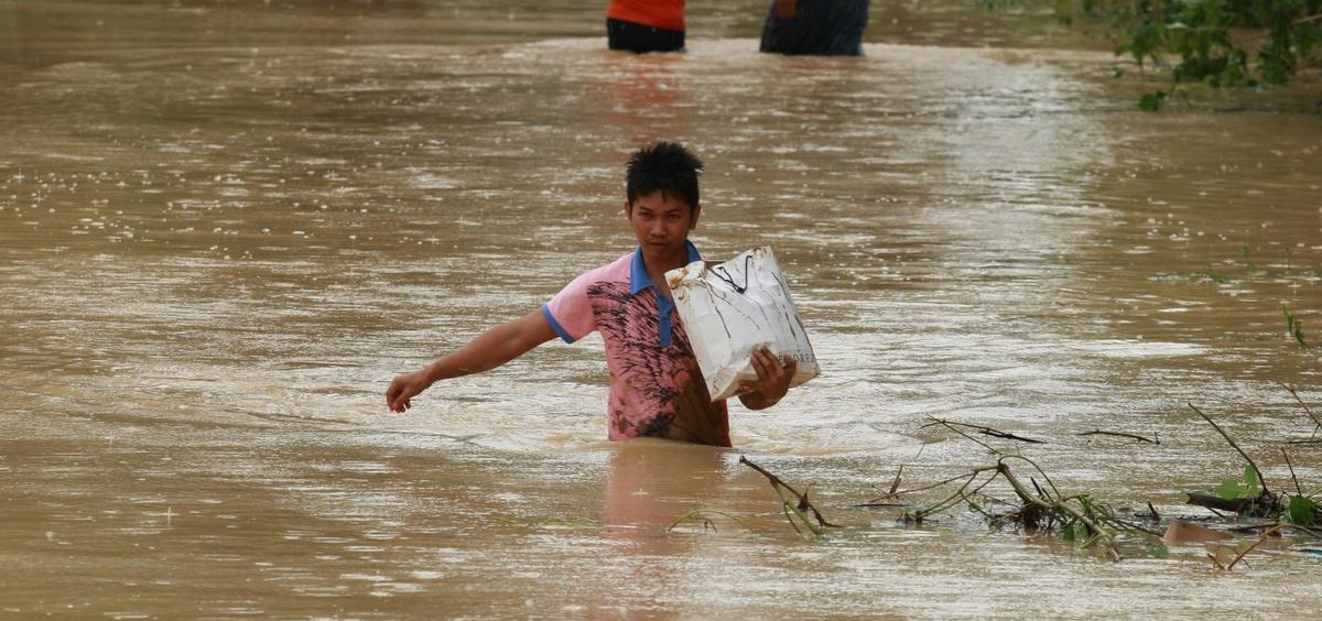 In this picture shows residents cross flooded village in the aftermath of typhoon Koppu that hit Palayan city, Nueva Ecija province, Monday, October 19, 2015. Typhoon Koppu smashed in the Northern Philippines causing widespread damages to properties and crops as well displacing thousands of people.