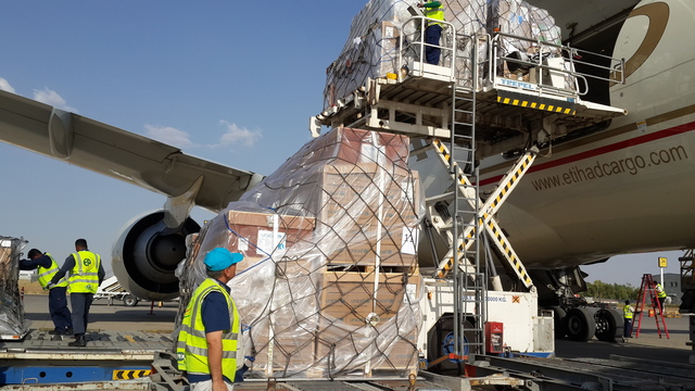 On 17 June 2014 in Iraq, (foreground) UNICEF Senior Supply/Logistics Assistant Kasim Muhamad supervises the loading of UNICEF emergency supplies onto an aeroplane at the airport in the northern-eastern city of Erbil in Kurdistan Region. The supplies, which include tents, blankets, hygiene and recreation kits, and education materials, are part of a shipment of 33 metric tons of emergency relief items earmarked for children and families displaced by violence and fighting that first erupted in the city of Mosul on 5 June. Up to 1 million people are currently estimated displaced, including about 500,000 Mosul residents – up to half of whom are children. UNICEF and partners are working to meet the rapidly rising needs of those affected by the worsening crisis. Immediate priorities include safe drinking water and adequate sanitation, as well as critical emergency immunization to prevent the spread of diseases such as polio, which has re-emerged in Iraq this year, and measles.