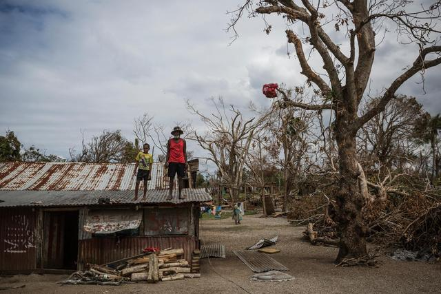 (Foreground) a child and an elderly man stand on the roof of a dwelling damaged Cyclone Pam, on Ifira Island, just off the coast of the main island of Efate. On 25 March 2015 in Vanuatu, 166,000 people remain affected following the destruction caused by Tropical Cyclone Pam, which hit the South Pacific island nation on 13 March. Nearly 60,000 of them are children. The Category 5 storm damaged infrastructure and disrupted key services, putting children's health, safety and education at risk. Power, water supply and other critical infrastructure have been affected across the archipelago, including in Port Vila, the capital, on Efate Island. Health and other vital services in many areas have also been disrupted, including access to safe drinking water and sanitation facilities, leading to increased risk of water- and vector-borne diseases. Many homes and schools have also been damaged or destroyed. At least 70,000 school-aged children are out of school; and early childhood centres, schools, churches and community halls are serving as evacuation centres and as emergency shelters. Working with the Government and partners, including other United Nations organizations, UNICEF is supporting water, sanitation and hygiene (WASH), health, education, nutrition, protection and other critical services in affected communities. UNICEF, with the World Health Organization (WHO) and the Ministry of Health, is also coordinating a measles-rubella prevention campaign in the country – where immunization rates are low, and which experienced a measles outbreak in early March. UNICEF is also supporting communities on Tuvalu and Solomon Island, which have also been affected by Tropical Cyclone Pam.