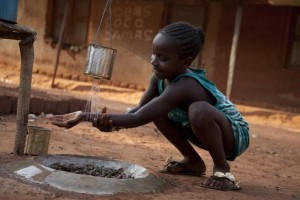 A girl washes her hands at a basic hand-washing station after using the latrine, in a small village located between Gabú and Bafatá Regions. The village has achieved open-defecation-free (ODF) status, indicating that the entire village has committed to building and using latrines and has renounced open-air defecation, thereby also protecting its water supply from contamination by human excreta. Latrines, one for each extended family, as well as hand-washing stations, have been built by residents with UNICEF support. [#2 IN SEQUENCE OF TWO] In November/December 2012 in Guinea-Bissau, a vaccination campaign against measles was held as part of an effort by the Government and the Measles & Rubella Initiative, a multi-partner effort led by the American Red Cross, the United Nations Foundation, the United States Centers for Disease Control and Prevention (CDC), the World Health Organization (WHO) and UNICEF. In Guinea-Bissau, political instability and deep poverty continue to contribute to limiting economic and social development. The country has the seventh-highest under-five mortality rate in the world, despite a decline (from 210 to 161 deaths per 1,000 live births) from 1990 to 2011, and maternal mortality is also high. One-third of the population and half of all rural inhabitants lack access to safe water. More than 80 per cent of the population have no access to sanitation. Cholera continues to be endemic, and HIV prevalence is 5.3 per cent among adults, with women disproportionately affected. Wide economic, gender and other disparities persist. Working with the Government, NGOs and others, UNICEF supports health; nutrition; water, sanitation and hygiene (WASH); education; and child protection interventions, including the Measles & Rubella Initiative. Worldwide, measles remains a leading cause of death among the youngest children: In 2011, some 158,000 people – mainly children under the age of 5 – died from the disease. Nevertheless, thanks to the Initiativ