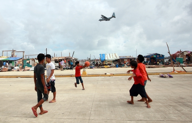 Children play basketball in the typhoon-hit town of Guiuan, Eastern Samar, Philippines.