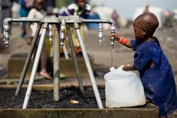 On 12 December, a small child fills a collapsible jerrycan with safe water at one of several outdoor taps in a Kibati camp for the displaced, near Goma, capital of North Kivu Province. UNICEF is working with the NGO Mercy Corps to distribute water via truck to tens of thousands of displaced people in Kibati and elsewhere. They are also providing water bladders and installing water pipes, as well as constructing latrines and promoting other hygiene interventions to prevent the outbreak and spread of disease.  By 15 December 2008 in the Democratic Republic of Congo, ongoing fighting between government and rebel forces in eastern North Kivu Province continued to threaten local populations and hinder relief efforts. More than 250,000 people are on the move, including more than 60,000 in camps for the newly displaced in the Kibati area, north of Goma, the provincial capital. Over 1 million people in the province are now displaced, with others fleeing across borders to Uganda and Rwanda. Malnutrition rates and hygiene-related diseases, especially diarrhoea and including cholera, are increasing; children are being recruited or re-recruited into armed groups; and hundreds of others have been separated from their families as they flee outbreaks of violence. UNICEF is calling for a cessation to fighting and to the recruitment of child soldiers, as well as for safe access to all vulnerable groups. UNICEF is also working to: provide safe water to camps for the displaced; build latrines to help prevent disease outbreaks; supply health centres; support measles immunizations; distribute basic non-food items; and support efforts to reunite children separated from their families. Partners include the Government and major donor countries; other UN agencies; and international NGOs, including Solidarité Internationale, International Medical Corps, the International Rescue Committee, Mercy Corps and Save the Children UK. UNICEF has requested US $12 million in additional emergency fundin