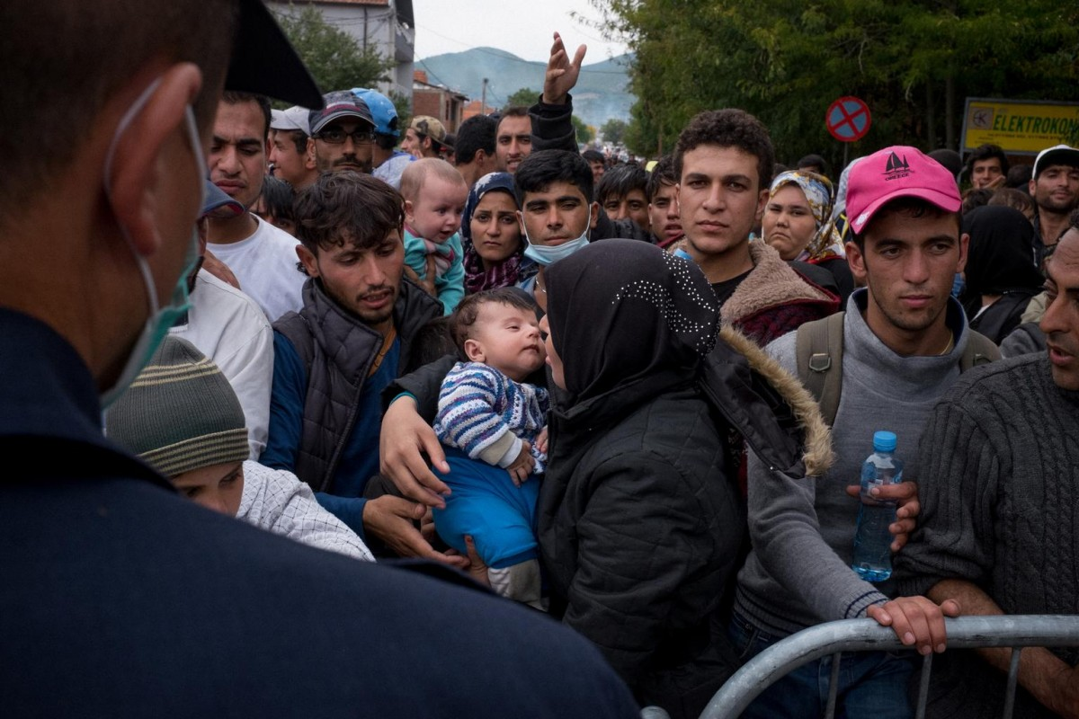 On 5 October 2015 in Serbia, (centre) a woman holds a small child as she queues at the reception centre for refugees and migrants in the town of Presevo, close to the border with the former Yugoslav Republic of Macedonia. Approximately 5,000 people crowded into Presevo, overwhelming the capacity of the reception centre.  In September 2015, growing numbers of refugees and migrants seeking safety in Europe continue to enter or pass through Serbia. Many of them are fleeing violence, conflict and insecurity in their countries of origin. By 25 September, 141,259 people had expressed their intent to seek asylum in the country. They are among the 487,497 refugees and migrants who have arrived in Europe by sea in 2015. About one in every four asylum seekers in Europe so far this year has been a child. More than 130,000 children sought asylum between January and July – an average of over 18,000 children every month. A significant number of children are travelling unaccompanied or have become separated from their families on the move. As if their current plight were not distressing enough, the vast majority of children seeking refuge in Europe are escaping horrors we can only imagine – half of those arriving in Europe across the Mediterranean Sea so far this year are Syrians. UNICEF estimates that as many as 320,000 refugee and migrant women and children in Europe could be in need of assistance over the next six months. Beyond UNICEF's deep involvement in responding to the crises in the Syrian Arab Republic and neighbouring countries, UNICEF is active in supporting migrant and refugee children in European countries where it has existing programmes. In response to the crisis, UNICEF, working with the Office of the United Nations High Commissioner for Refugees (UNHCR) and other UN organizations and partners, is supporting government efforts to provide food, shelter, water, sanitation and hygiene (WASH), health, protection and other vital humanitarian assistance for refu