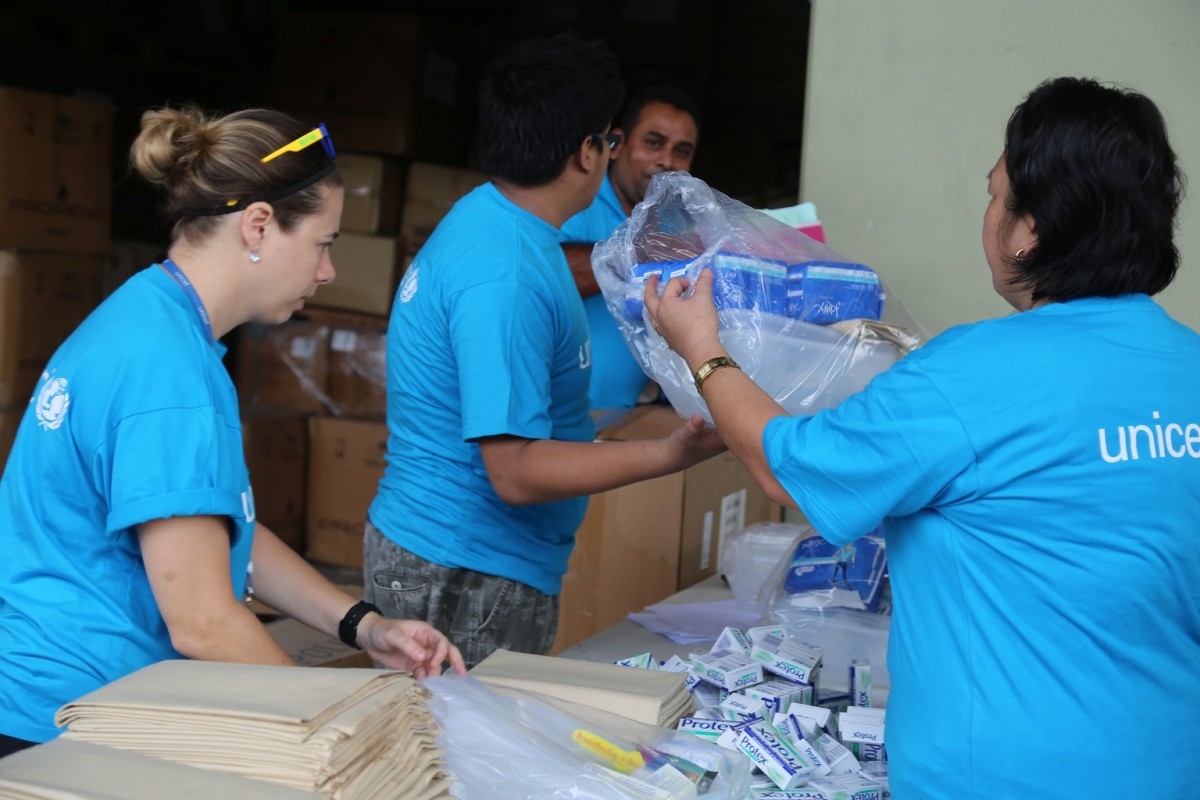 "On 22 February 2016, UNICEF staff and volunteers pack WASH kits (water, sanitation and hygiene kits) and school supplies at UNICEF's warehouse in Suva, Fiji. Category 5 Tropical Cyclone Winston made landfall in Fiji on Saturday 20 February, continuing its path of destruction into Sunday 21 February.  A state of natural disaster and a nationwide curfew had been declared by the Government of Fiji earlier in the evening. Flights in and out of Fiji were also cancelled due to the extreme weather. Power lines are down and communications are limited but UNICEF Pacific Communications Specialist and New Zealander, Alice Clements, has said from her Suva base, ""We certainly felt the impact of TC Winston in Suva with destructive, howling winds and the sound of rivets lifting from roofs a constant throughout the night.   ""We can't say for sure yet how the rest of the country fared but rapid assessments will be undertaken by the Fiji Government to determine the full impact and what response will be required.  It is likely that smaller villages across Fiji will have suffered the most, given their infrastructures would be too weak to withstand the power of a category 5 cyclone. Families may have lost their homes and crops therefore leaving them without shelter, food and a livelihood. Those families will have lost everything. There is also considerable risk for those that live by the sea or rivers as flash flooding and river flooding could occur due to heavy rains."" UNICEF is a member of the Pacific Humanitarian Team and will be on standby to provide emergency supplies and additional personnel, if required.  UNICEF has prepositioned supplies in Suva and Nadi including water kits, health kits and education materials such as school tents. If called on to assist, UNICEF will actively support the Fiji Government in leading clusters of agencies working in water and sanitation, education and nutrition, and in child protection. as tarpaulins."