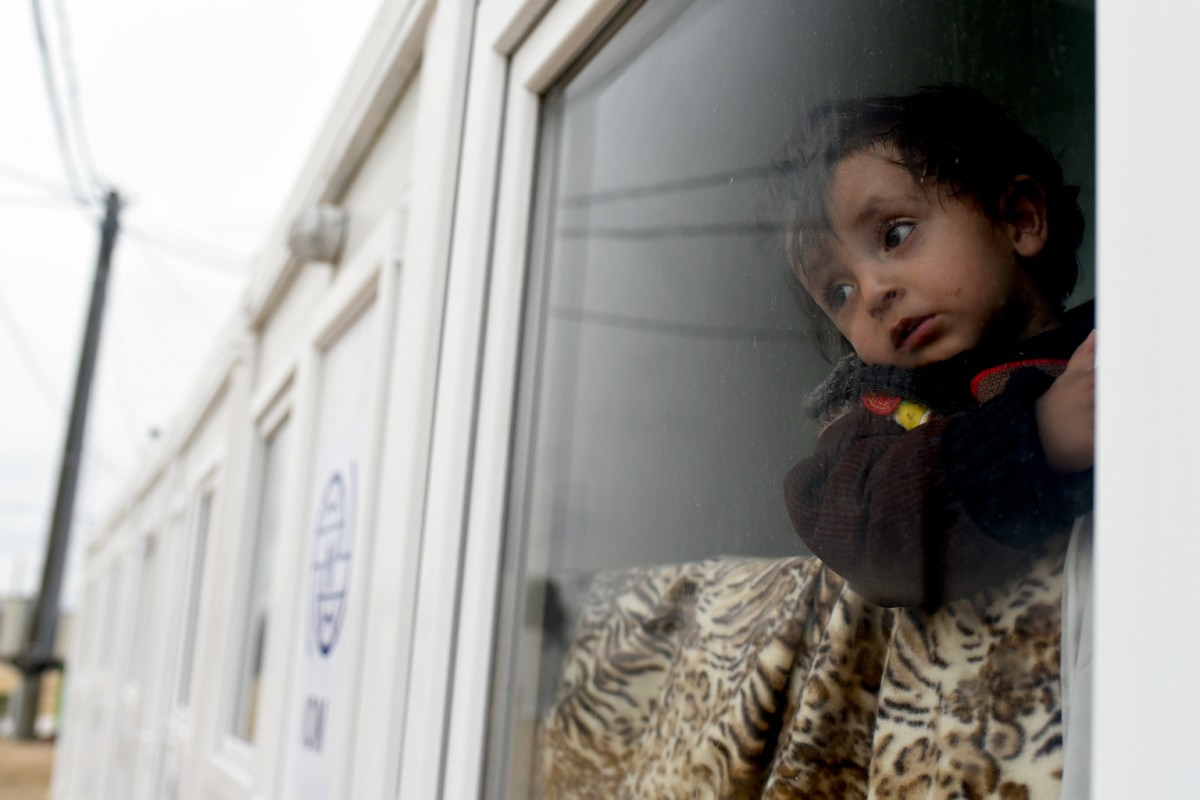 On 20 February 2016, a young child looks out of the window of the UNICEF child friendly space at the Tabanovce reception centre for refugees  in the former Yugoslav Republic of Macedonia after being refused entry into Serbia. Hundreds of Afghan refugees, including children and women, are stuck in freezing conditions in Tabanovce in the former Yugoslav Republic of Macedonian as border changes in the Balkan region create confusion and chaos. UNICEF-branded bags are distributed routinely in Tabanovce to women with small children who need to carry children's items. UNICEF-branded bags are distributed routinely in Tabanovce to women with small children who need to carry children's items.  Hundreds of Afghan refugees, including children and women, are stuck in freezing conditions in Tabanovce in the former Yugoslav Republic of Macedonian as border changes in the Balkan region create confusion and chaos.
