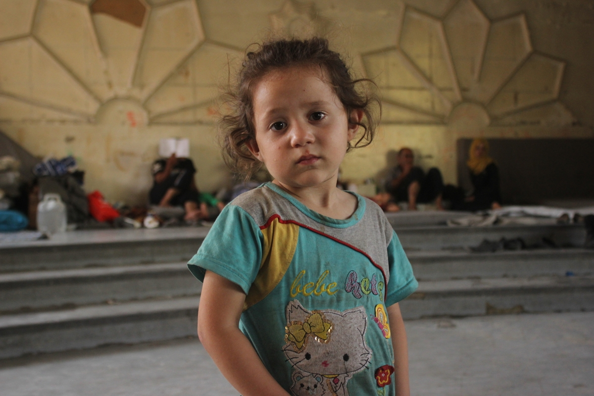 On 5 August 2016 in Aleppo city in the Syrian Arab Republic, displaced families from Reyadeh and 1070 neighbourhoods take shelter at the Teshreen Kindergarten in western Aleppo city, which has just opened its doors to accept displaced families after the latest wave of attacks. Conditions are still extremely basic.