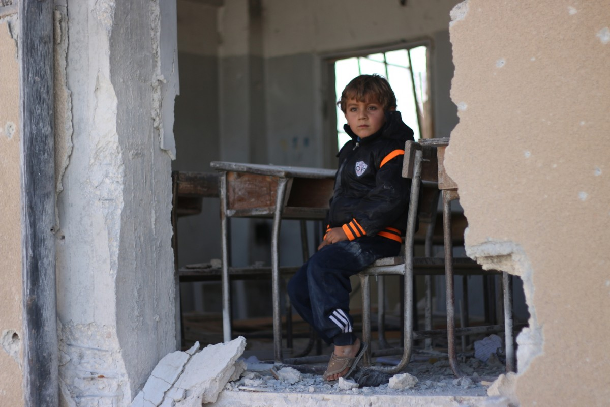 "On 31 October 2016 in Idleb in the Syrian Arab Republic, Ahmad, 6, says, ""I wanted to become a doctor but perhaps I won't become anything because our school was [attacked]."" ""We used to play a lot in the schoolyard but now I'm afraid of coming here. My dad might take us to another school in another village."""
