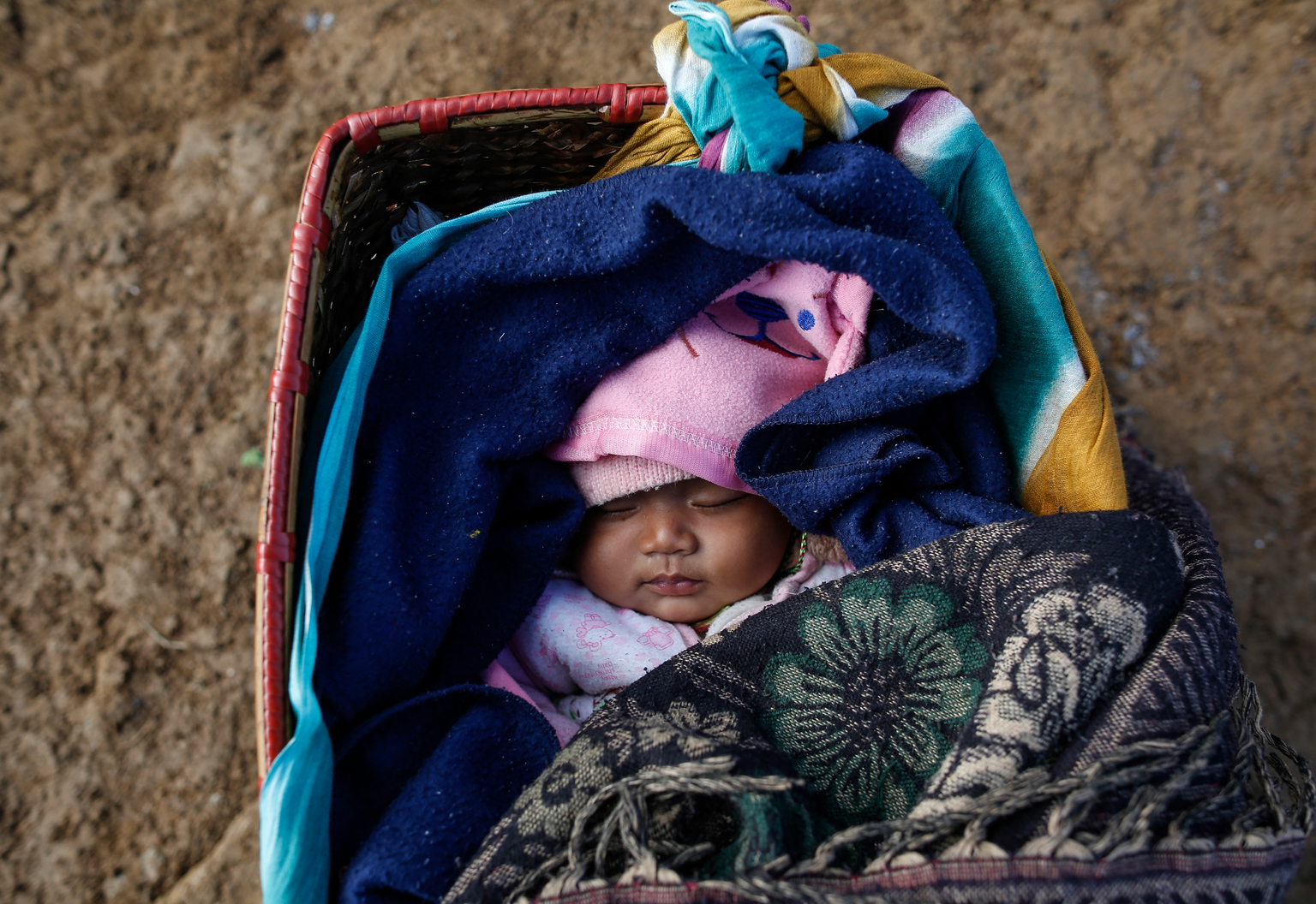 On 17 January 2016, a four month old baby boy born to Nepalese mother Sundari Gurung , aged 22, at her temporary shelter in Gupsi Pakha, in Laprak, in Gorkha district, Nepal. Both Sundari and her farther-in-law lost their homes during April 2015 earthquake and have been living in Earthquake Camp in Gupsipakha. The ongoing winter season and top of snowfall have been affecting her child, says Sundari. Laprak is one of the epicenter villages of Gorkha district, where more than 600 hundreds houses were destroyed during earthquake on 25 April 2015. Hundreds of earthquake victims, particularly the elderly and young children living in shelter of highland altitude have been facing a harsh winter season after snowfall.