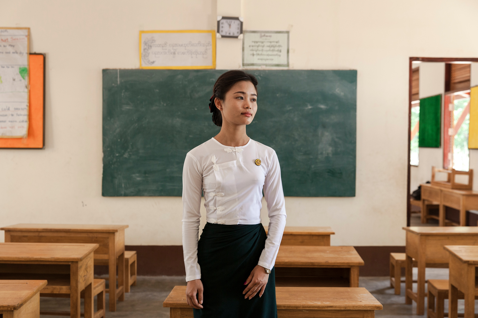 """Nan Maw Maw Kyi, a teacher at the local school who was one of the first at the scene when Min Thiya, 10, and his friend Saw Ba Sun, 9, and two others were injured when they were playing with metallic object that exploded and killed their friend So Aung Myo Win, at the Ann Ka Law village in Kyin State in Myanmar, Monday 3 April 2017. """"We always tell the children: if you find anything strange or unusual in the forest, never touch it, but go and tell an adult."""" says Nan Maw Maw Kyi, but she adds: """"Unfortunately we can't say for certain that something similar won't happen again."""" In 2017, working with the Government of Myanmar, UNICEF will strive to meet the basic needs of the most vulnerable internally displaced children. Myanmar is experiencing three protracted humanitarian crises, each with its own set of complex underlying factors. In Rakhine State, inter-communal violence that erupted in 2012 continues to plague 120,000 internally displaced people spread across 40 camps or informal sites, as well as host communities. Eighty per cent of the displaced are women and children. In Kachin State, armed conflict that reignited in 2011 continues to impact communities caught in the crossfire between an ethnic armed group and the Myanmar army. Nearly 87,000 people remain displaced as a result, including 40 per cent who are in areas outside of government control. An additional 11,000 people remain displaced in northern Shan State, where a similar conflict broke out in 2011. Compounding the protracted crises are issues related to religious and/or ethnic discrimination, exploitation, chronic poverty, vulnerability to natural disasters, statelessness, trafficking and humanitarian access. In addition to the humanitarian crises in Rakhine, Kachin and Shan states, Myanmar is impacted by humanitarian situations in other parts of the country, including natural disasters, health emergencies and small-scale displacements."""