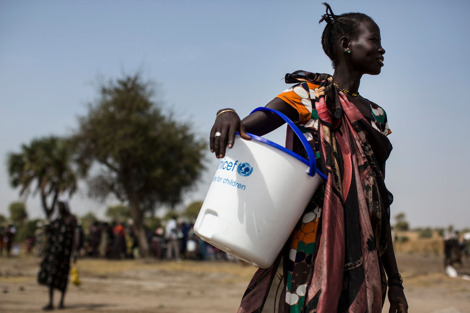 A woman holds a UNICEF donated bucket during a Rapid Response Mission (RRM) in the village of Rubkuai, Unity State, South Sudan, February 16, 2017. In 2017 in South Sudan, ongoing insecurity, combined with an economic crisis that has pushed inflation above 800 percent, has created widespread food insecurity with malnutrition among children having reached emergency levels in most parts of the country. In 2016, UNICEF and partners admitted 184,000 children for treatment of severe malnutrition. That is 50 percent higher than the number treated in 2015 and an increase of 135 percent over 2014. In February 2017, war and a collapsing economy have left some 100,000 people facing starvation in parts of South Sudan where famine was declared 20 February, three UN agencies warned. A further 1 million people are classified as being on the brink of famine. The Food and Agriculture Organization of the United Nations (FAO), the United Nations Children's Fund (UNICEF) and the World Food Programme (WFP) also warned that urgent action is needed to prevent more people from dying of hunger. If sustained and adequate assistance is delivered urgently, the hunger situation can be improved in the coming months and further suffering mitigated.  The total number of food insecure people is expected to rise to 5.5 million at the height of the lean season in July if nothing is done to curb the severity and spread of the food crisis. According to the Integrated Food Security Phase Classification (IPC) update released 20 February by the government, the three agencies and other humanitarian partners, 4.9 million people – more than 40 percent of South Sudan's population – are in need of urgent food, agriculture and nutrition assistance. Unimpeded humanitarian access to everyone facing famine, or at risk of famine, is urgently needed to reverse the escalating catastrophe, the UN agencies urged. Further spread of famine can only be prevented if humanitarian assistance is scaled up and