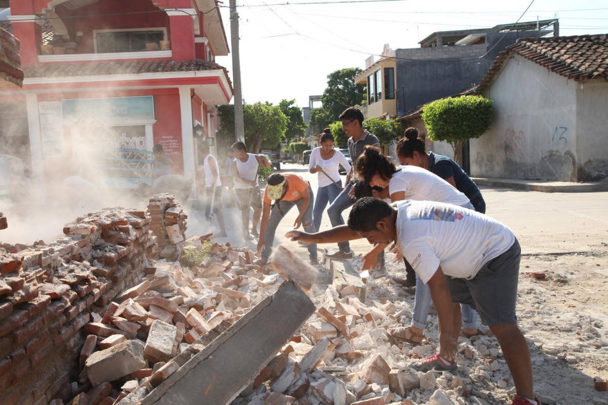 On 9 September 2017 in Oaxaca, Mexico, adolescent volunteers from San Blas Atempa help to remove debris and clear the streets of San Mateo del Mar affected by the earthquake.