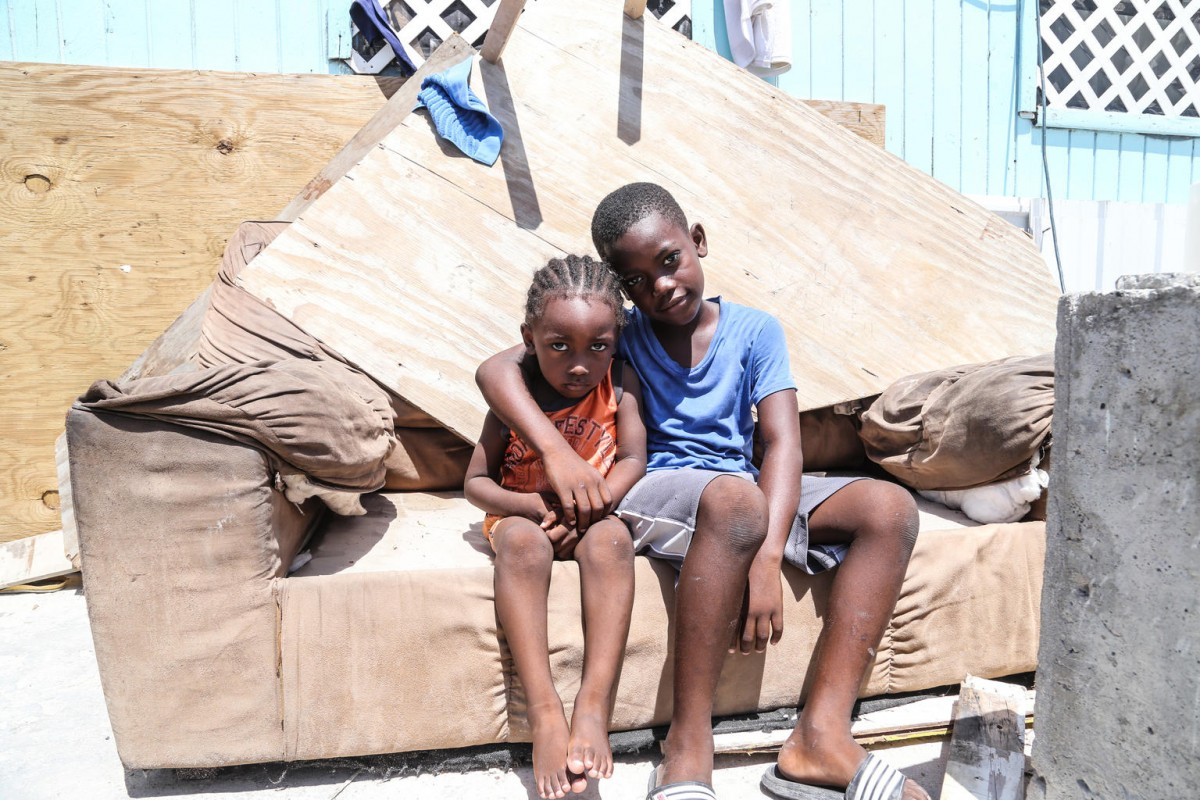 (Right) Lovens Pervil, 7, and is brother Emmanuel Pervil, 2, sit on a sofa outside their home, which was severely damaged by Hurricane Irma in Grand Turks, Turks and Caicos Islands, Friday 15 September 2017.