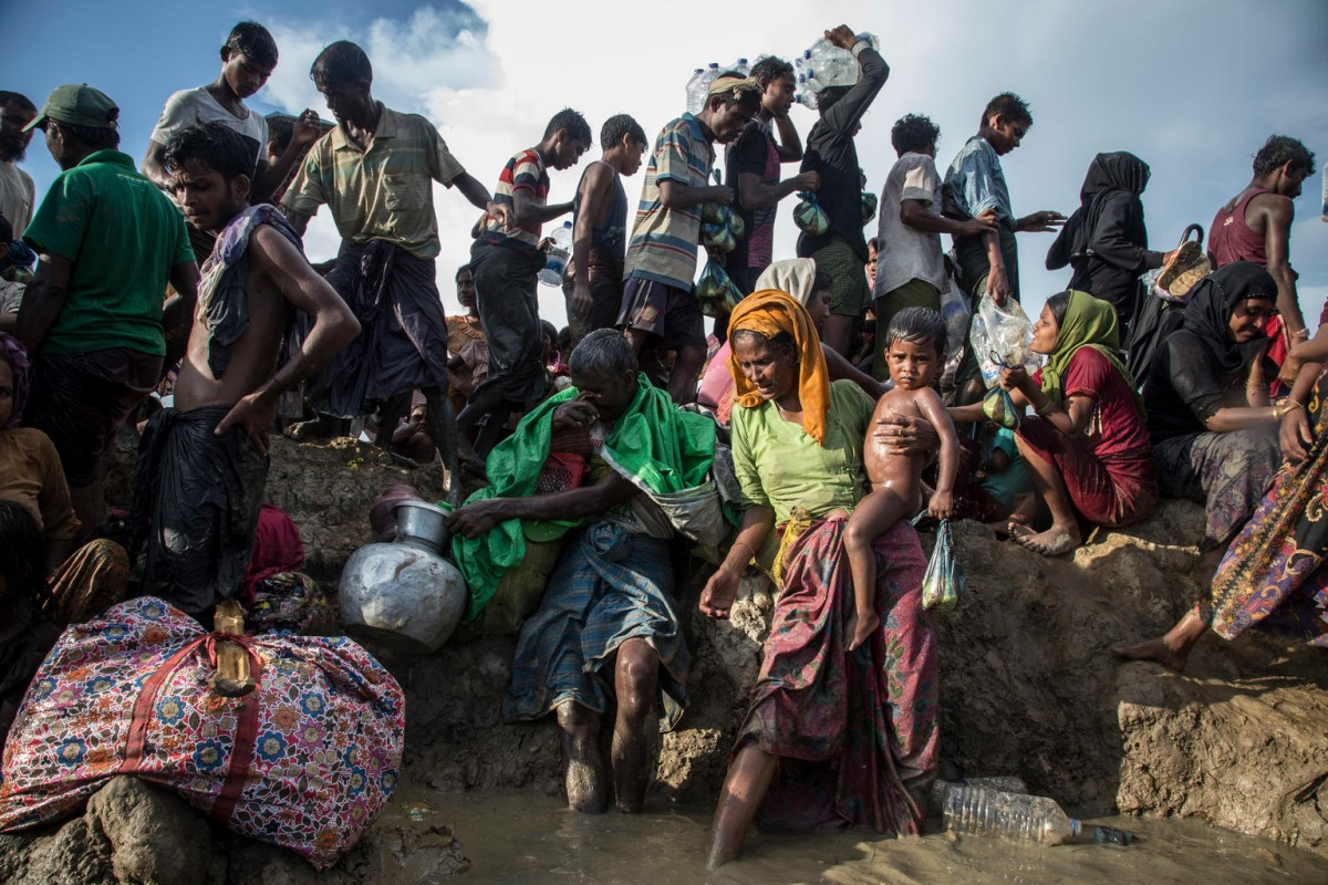 On 16 October 2017, Rohingya refugees including women and children cross into Bangladesh at Palong Khali in Cox's Bazar district. Between 10000 and 15000 newly arrived Rohingya refugees fleeing Myanmar crossed into Bangladesh, and are stuck in Palong Khali in Cox's Bazar district approximately 2 kms from the border with Myanmar.  Thousands of people are queuing up on pedestrian road in the midst of paddy fields and waterbodies in a queue approximately 1 km long. Thousands among them are children. People making long journeys by walking and crossing the river are in desperate condition. They are exhausted, dehydrated, hungry and are urgently in need of water. People are getting sick due to dehydration, while lots are also traumatized. Some children have been separated from their families during their journey. UNICEF has mobilized resources for the newly arrived Rohingyas. Two water trucks carrying 6000 litres of water and 2000 jerrycans are on the site for distribution. Distribution started this morning by boat to the refugees located near the border area.  Another 20,000 bottles of water each containing 1.5 litre are on the way from Chittagong. UNICEF is prepositioning two mobile child friendly spaces at the site for assessment and family tracing and reunification. UNICEF also plans to mobilize immunization and nutrition screening for this new influx.  Two UNICEF nutrition and health teams are currently on the ground.
