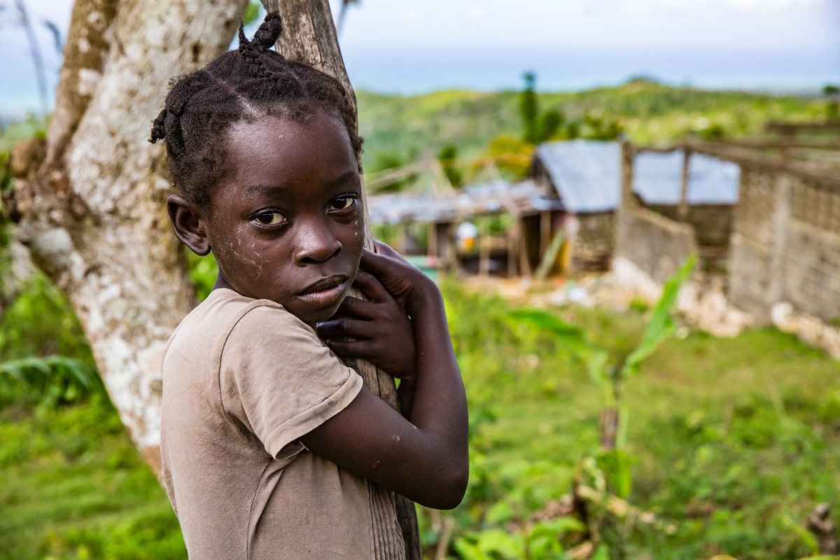 A child stands for a photograph near the destroyed École Mixtes Pierre Louis Marie in Dame-Marie, Haiti, Tuesday 8 November 2016.