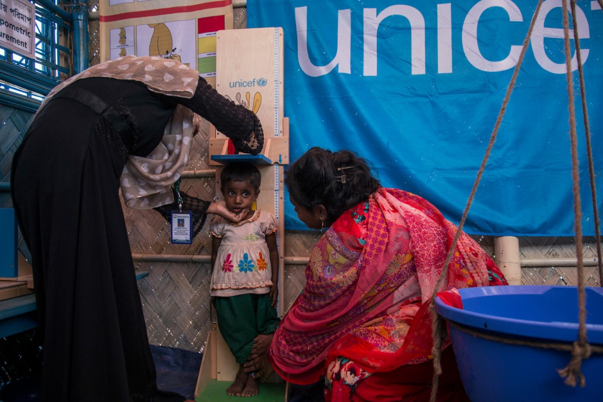 A girl has her height recorded at a UNICEF outpatient therapeutic feeding centre at the Balukhali makeshift refugee camp in Cox's Bazar, Bangladesh, Sunday 15 October 2017.  As at 20 October 2017, well over half a million Rohingya people have crossed into Bangladesh's southern district of Cox's Bazaar since late August after escaping horrific violence in neighbouring Myanmar. They have joined some 200,000 others who came in earlier refugee influxes. Almost 60 per cent of the latest arrivals are children, crossing at a rate of between 1,200 and 1,800 per day.  High levels of severe acute malnutrition among young children have been found in the camps, and antenatal services to mothers and babies are lacking. Support for children traumatised by violence also needs to be expanded. Expanding the provision of safe water, sanitation and improved hygiene for Rohingya children is the top priority, amid concerns over a possible outbreak of diarrhea and other waterborne diseases. Most Rohingya children are not fully immunized against diseases such as measles. UNICEF is also focused on providing Rohingya children with learning and support services in child-friendly spaces, and working with our partners to address gender-based violence. UNICEF is calling for an end to the atrocities targeting civilians in Myanmar's Rakhine State, and for humanitarian actors to be given immediate and unfettered access to all children affected by the violence there.  At present, UNICEF has no access to Rohingya children in Northern Rakhine State. At the end of September 2017, UNICEF announced that it is planning to establish more than 1,300 new learning centres for Rohingya children who have fled Myanmar to neighbouring Bangladesh. UNICEF is running 182 learning centres in Rohingya camps and makeshift settlements in Cox's Bazar, and has enrolled 15,000 children. It plans to increase the number of learning centres to 1,500, to reach 200,000 children over the next year. The learning cent