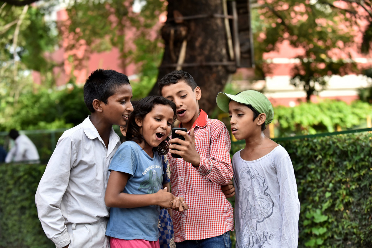 Children from slums and mobile phone use, at St. Columba's School, Delhi, Date 31-08-2016  Photo By Ashutosh Sharma/UNICEF