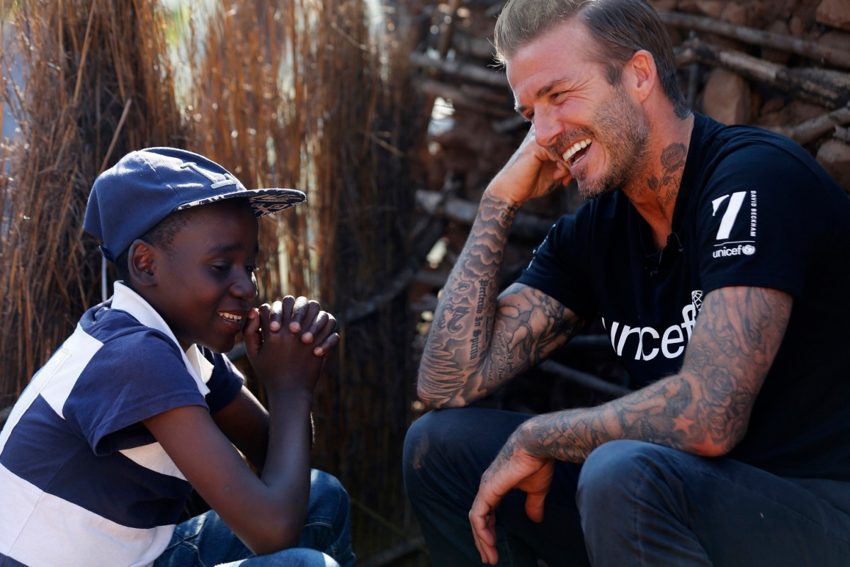 UNICEF Goodwill Ambassador David Beckham meets Sebenelle, 14, in Makhewu, Swaziland, on June 7, 2016, who receives the 7 Fund support in management of malnutrition in HIV positive children. Beckham travelled to Swaziland to see how 7: The David Beckham UNICEF Fund is helping UNICEF to provide life-saving treatment, care and support to HIV-positive children. During his visit Beckham learnt how the worst drought in decades – now taking hold on vast swathes of Eastern and Southern Africa – is threatening to wreak havoc on the lives of children and families already made vulnerable by HIV.   Makhewu, Swaziland, June 7, 2016. © UNICEF/Swaziland/Modola16