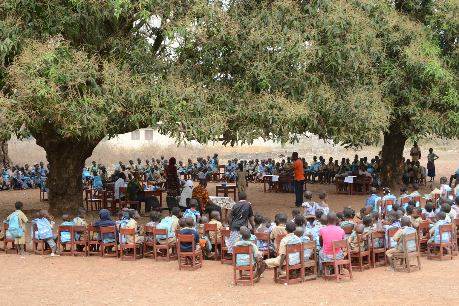Children gather for a reading club at a primary school in Koro, near Touba, Côte d'Ivoire, Friday 19 February 2016. After years of conflict Côte d'Ivoire is now repositioning itself in Africa with the aim of becoming an emerging economy by 2020. With economic growth estimated at 9 percent, investors are streaming in. Yet nearly 50 percent of the population still lives in poverty. Maternal and child mortality, education, health care and protection of women and children remain key challenges. Significant progress has been made in Côte d'Ivoire since education became compulsory for children aged 6 to 16 in 2015 - the enrolment rate rose from 79% in 2015 to 88% in 2016. However, the number of children out of school remains high, especially in the northern and the western regions of the country. UNICEF is supporting the development of the Education Sector Plan (2016–2026) and also helping the Ministry of Education and partners to identify and address the reasons why children are not in school. One of the challenges Côte d'Ivoire still has to address is gender disparity. When faced with the choice, parents routinely choose to send boys to school before girls, a gap which widens significantly at secondary school level. Girls are also more likely to drop out of school because of early pregnancy and marriage, to care for younger siblings or to undertake other household chores.